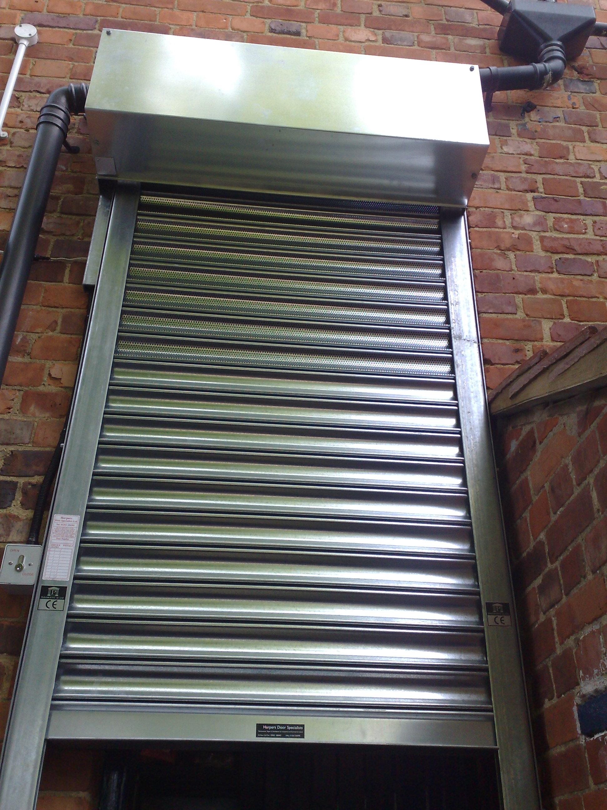 Steel security shutter over a door.