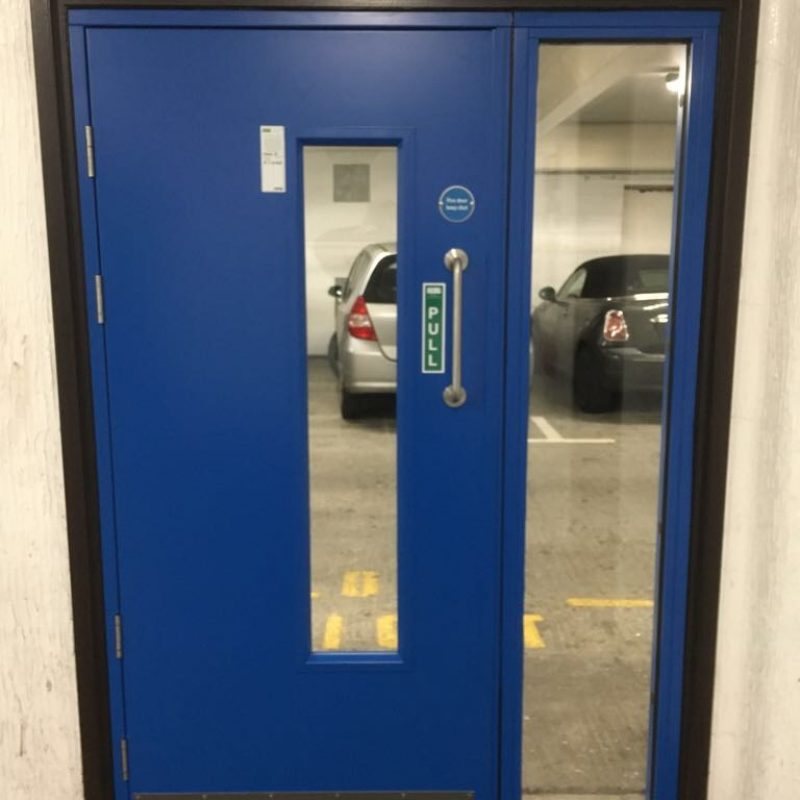 Fire rated car park door with fire rated glass and side screen