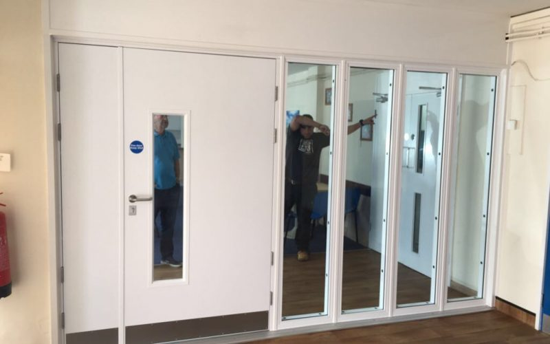 Fire rated doors with fire rated side screens